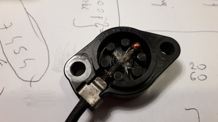 The neutral switch in Suzuki DR350S inside in closeup