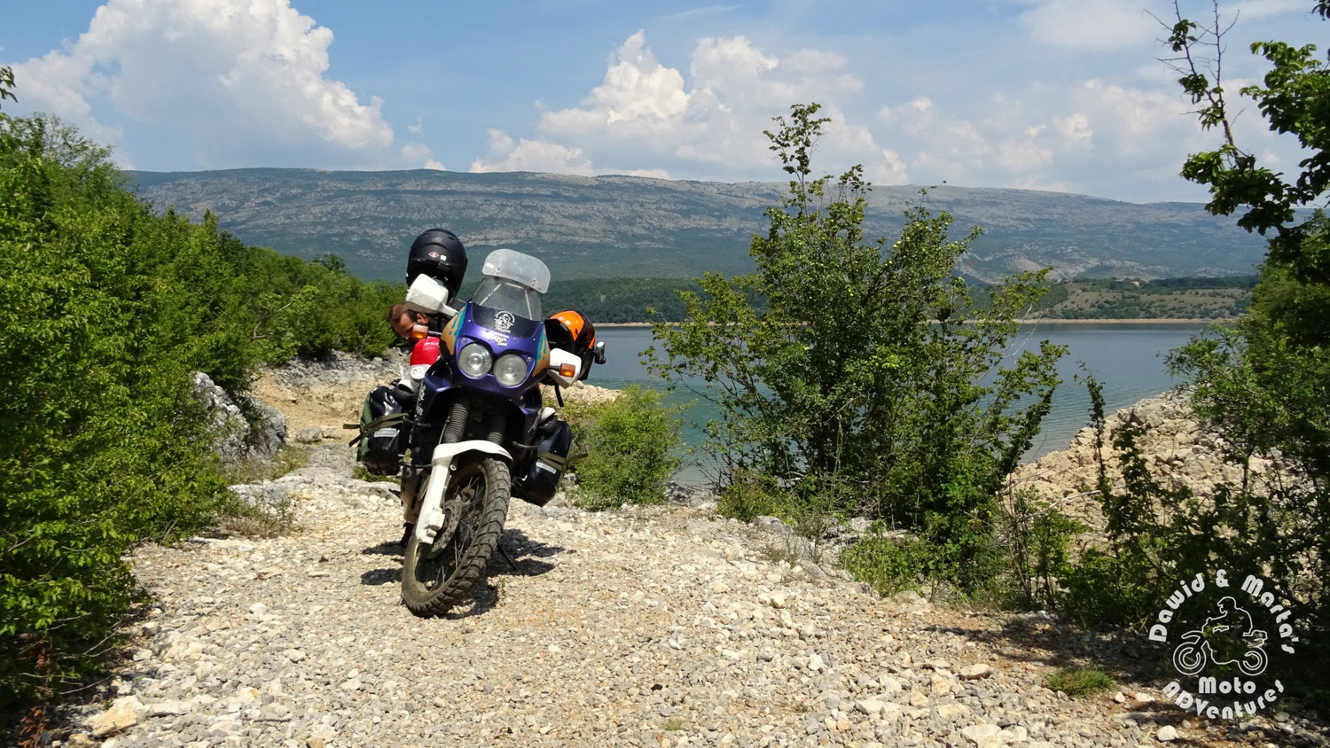 View on the Peruca Lake with Africa Twin in the foreground