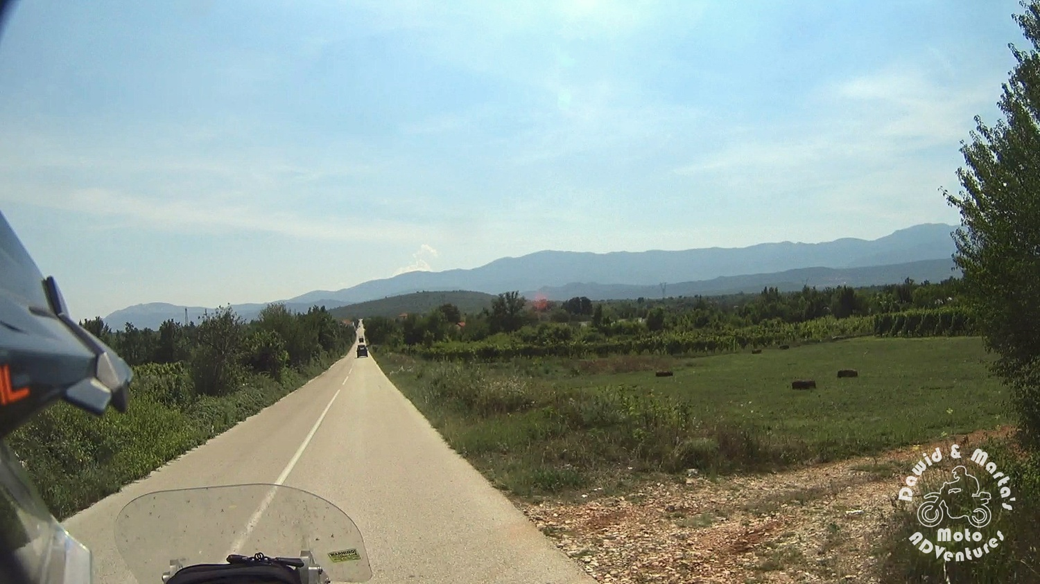 Riding motorcycle through road D60 in Croatia